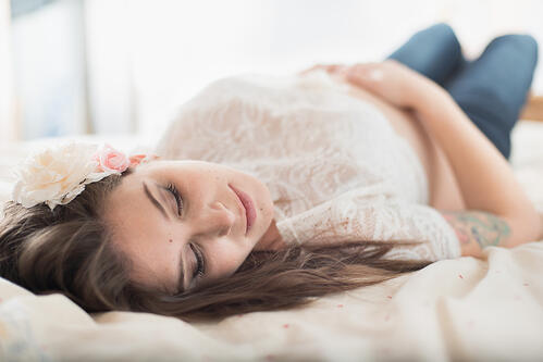Natural light portrait of a pregnant young woman